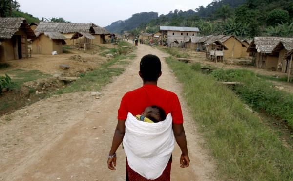 A woman walks down the main road in the village of Luvungi in the Democratic Republic of the Congo. In 2010, Hutu rebels and local militias raped more than 280 women and children as punishment for the villagers' alleged support of the Congolese Defense Fo