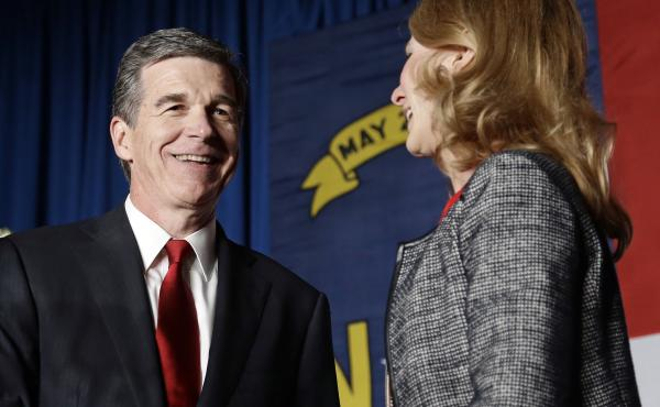 Democratic Gov.-elect Roy Cooper defeated incumbent Pat McCrory in a tight election. Cooper is seen here with his wife, Kristin, at an election night rally in Raleigh.