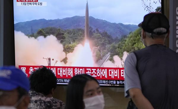 People watch a TV showing a file image of North Korea's missile launch during a news program at the Seoul Railway Station in Seoul, South Korea, Tuesday, Sept. 28. North Korea on Tuesday fired a suspected ballistic missile into the sea, Seoul and Tokyo of