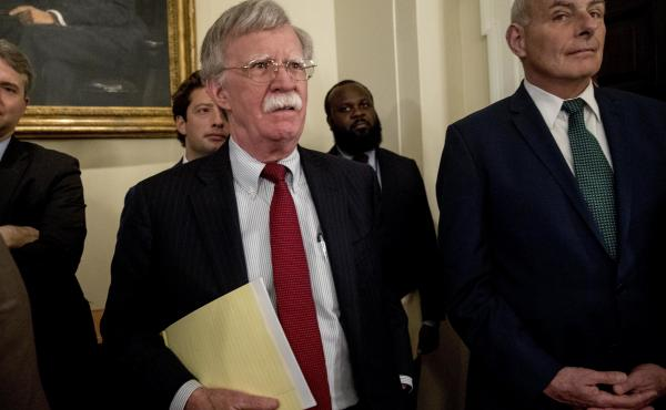 National security adviser John Bolton, center, and President Trump's chief of staff John Kelly, right, attend a Cabinet meeting in the White House, Tuesday, last month.