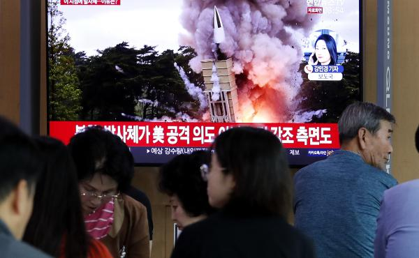 People at the Seoul Railway Station watch a newscast showing a file image of a North Korean missile launch. North Korea on Wednesday fired projectiles toward its eastern sea, South Korea's military said, in an apparent display of its expanding military ca