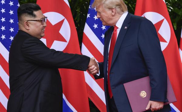 North Korean leader Kim Jong Un (left) and President Trump shake hands at the conclusion of their first summit in Singapore last year. North Korea says preparations for a second summit are underway.