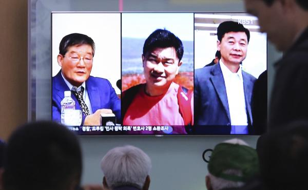 People watch a TV news report in Seoul, South Korea, on May 3, as the screen shows portraits of three Americans detained in North Korea: Kim Dong Chul (left) Tony Kim and Kim Hak-song (right). Three American prisoners in North Korea were released into U.S