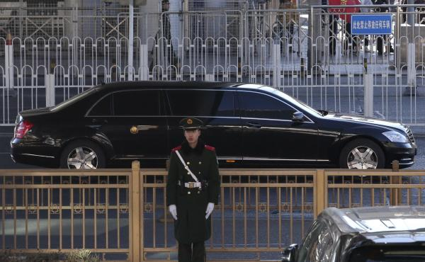 A sedan, believed to carry North Korean leader Kim Jong Un, leaves a train station with a convoy in Beijing. Kim is making a four-day trip to China in what's likely an effort to coordinate with his only major ally ahead of a summit with President Trump th