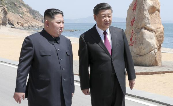 Chinese President Xi Jinping walks with North Korean leader Kim Jong Un during a meeting in May in Dalian, a city in China's northeastern Liaoning Province.