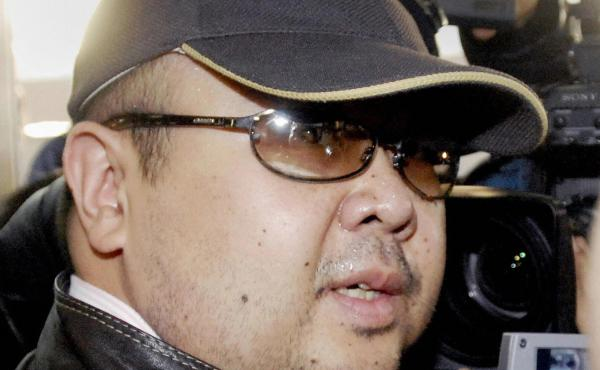 A man believed to be Kim Jong Nam is surrounded by journalists upon his arrival at a Beijing airport in February 2007.
