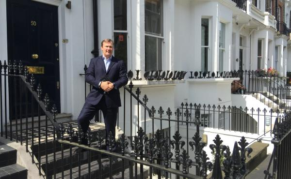 Realtor Simon Rose stands in front of a home he's working to sell in London's Chelsea neighborhood. The home is on the market for a little over $7 million, but the asking price has been cut $700,000 since Britain voted in June to leave the European Union.