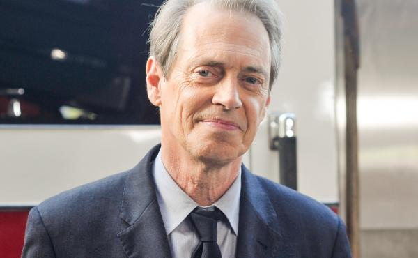 Steve Buscemi poses for photographers during the A Good Job: Stories Of THe FDNY New York premiere on Sept. 4, 2014 in New York City.