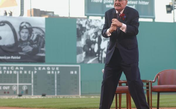"""Humorist and Boston Red Sox Poet Laureate Dick Flavin recites """"Teddy at the Bat"""" during the Ted Williams tribute on July 22, 2002 at Fenway Park in Boston."""