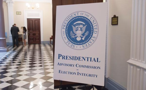 A sign appears outside the room where the first meeting of the Presidential Advisory Commission on Election Integrity in the Eisenhower Executive Office Building in Washington, DC, July 19, 2017.