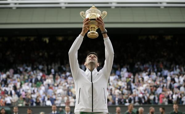 Novak Djokovic celebrates after defeating Roger Federer in the men's singles final match of the Wimbledon Tennis Championships in London.