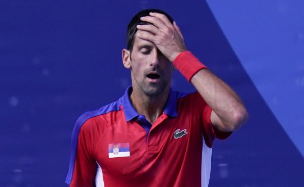 Novak Djokovic of Serbia reacts during the bronze medal match that he lost to Spain's Pablo Carreño Busta at the Tokyo Olympics on Saturday.