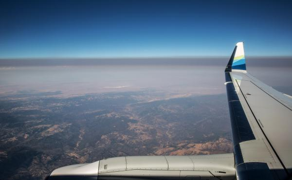 A thick layer of smoke from the Carr Fire settles over California's Central Valley in a view from a jet earlier this summer. Fine particulate matter from drifting wildfire smoke mixes with industrial ozone and can become trapped between the mountain range