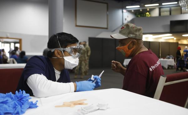Florida's Pasco County Health Department and the Army National Guard partnered with Fellowship Church in Tampa, Fla., to help city residents age 65 and older get immunized with the Moderna COVID-19 vaccine in February.