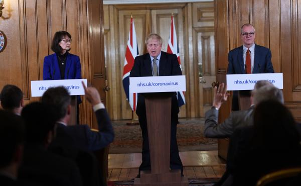 British Prime Minister Boris Johnson, Deputy Chief Medical Officer Dr. Jenny Harries and Chief Scientific Adviser Sir Patrick Vallance at a March news conference on the pandemic. That month, Harries stated that the World Health Organization recommendation