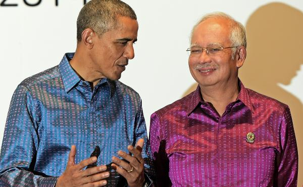 President Obama talks with Malaysian Prime Minister Najib Razak at the East Asia Summit in Myanmar in November. Obama is trying to strike a 12-country Trans-Pacific Partnership, which would include Malaysia.