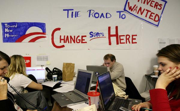 """Volunteers in Des Moines make calls at the campaign headquarters of then-Democratic presidential hopeful Sen. Barack Obama on Dec. 5, 2007 ahead of the Iowa caucus. Obama has called those """"fired-up"""" campaign workers from his 2008 campaign, one of his prou"""