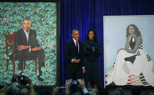 Former President Barack Obama and former first lady Michelle Obama stand next to their newly unveiled portraits during a ceremony at the Smithsonian's National Portrait Gallery on Feb. 12, 2018. The portraits are set to go on a yearlong tour to five citie