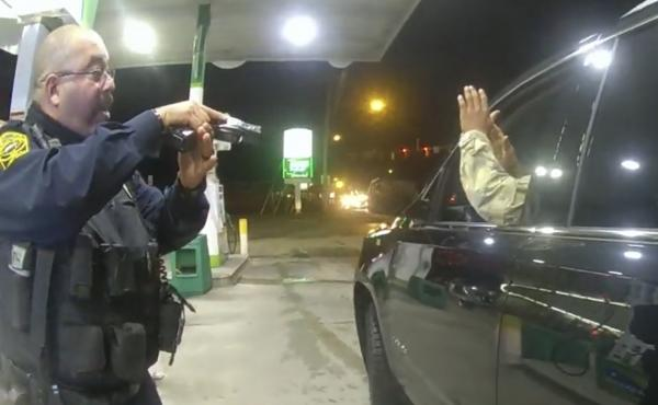 Officer Joe Gutierrez aims his weapon at Lt. Caron Navario during a traffic stop. Navario is suing Gutierrez and the other officer, Daniel Crocker, for violation of his constitutional rights.