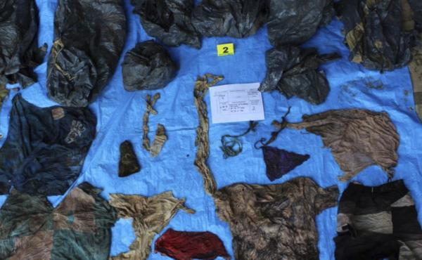 Mexican investigators found 200 garments at an undisclosed grave in the Gulf Coast state of Veracruz. The bodies were buried at least two years ago, Attorney General Jorge Winckler said Thursday.