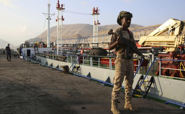 Yemeni militiamen stand guard at the port in Mukalla, on the southern coast of Yemen. Many factions are involved in Yemen's civil war. The U.S. has supported Saudi Arabia, which has waged a bombing campaign against Houthi rebels. But the U.S. Congress is