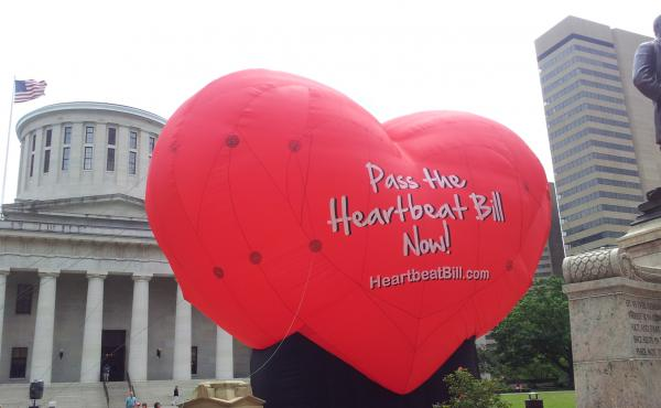 A large balloon in support of the Heartbeat Bill flies outside the Statehouse in Columbus, Ohio, in June 2012. More than four years later, the measure, which would ban abortions as soon as six weeks after conception, has passed the Legislature — after b