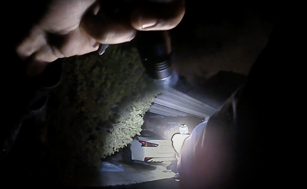 This image from a Columbus police body camera shows the moments before Officer Adam Coy fatally shoots Andre Maurice Hill early Tuesday.
