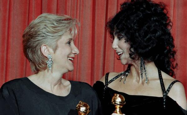 Olympia Dukakis and Cher hold the Golden Globe awards they received for performances in the hit movie Moonstruck in 1988. Later that awards season, they both won Oscars.