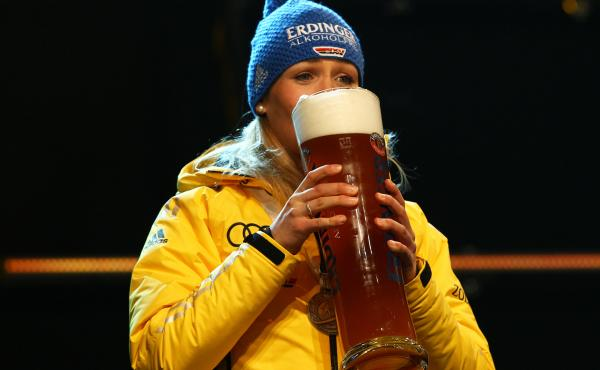 Magdalena Neuner of Germany enjoys a glass of Erdinger nonalcoholic beer after a medal ceremony at the biathlon world championships in Ruhpolding, Germany, in 2012. Today's Olympians have been swept up in a new trend largely emerging from Bavaria: nonalco