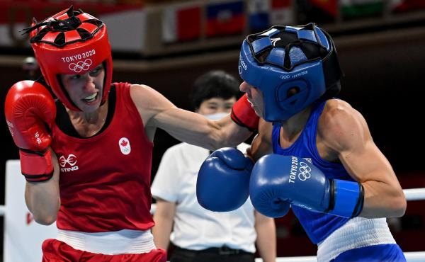 Mandy Bujold (L) of Canada exchanges punches with Nina Radovanovic of Serbia during the Women's Fly on Sunday at the Tokyo Olympics.
