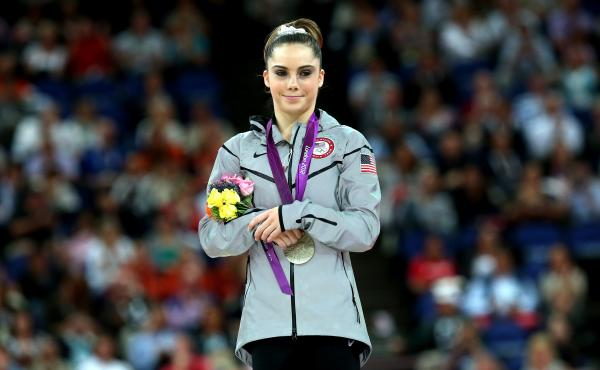 McKayla Maroney stands on the podium at the 2012 Olympic Games in London. She says a team doctor molested her for years, including during the Olympics.