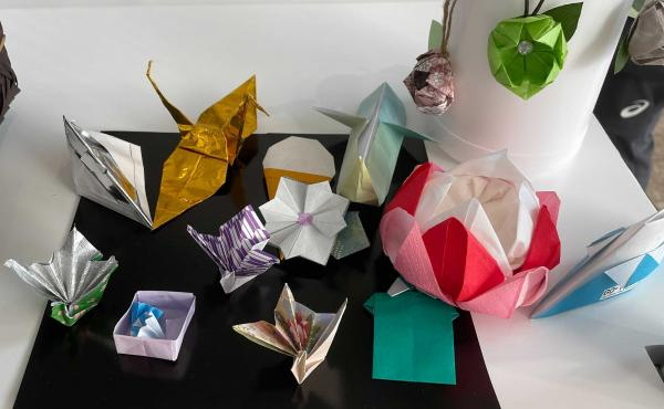 Volunteers at the center for media at the Tokyo Olympics made origami designs, including cranes and flowers.