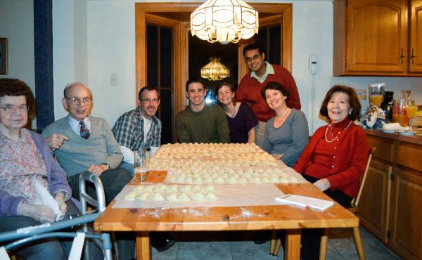 """The author and her family gathered around their prized Christmas Eve pierogi in 2012. On the far left is """"Grandmom"""" Cecelia Beans."""