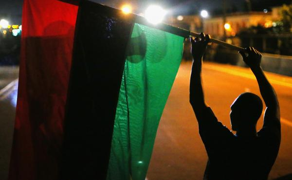 Demonstrators hold up a Pan-African flag to protest the killing of teenager Michael Brown on Aug. 12, 2014 in Ferguson, Mo.