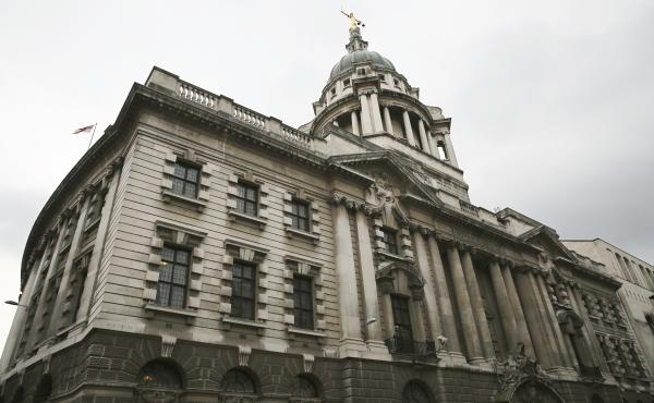 A statue of the scales of justice stands above the Old Bailey, the courthouse where many high-profile libel cases are tried, in London. The U.K. is a popular place for libel cases to be filed because of laws that make it difficult for journalists or the m