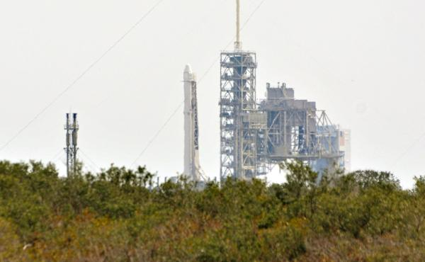 SpaceX's Falcon 9 rocket sits on the launch pad Saturday at Kennedy Space Center in Florida. SpaceX scrubbed the Saturday launch due to a technical issue. The company is tried again — and succeeded — on Sunday.
