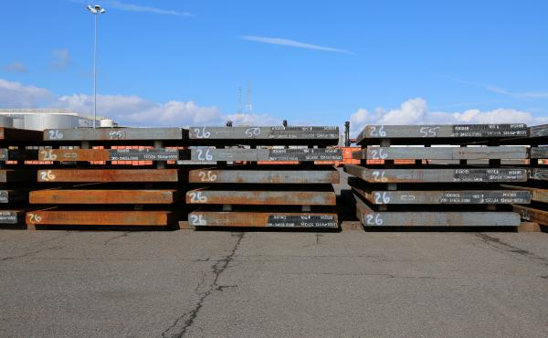 Slabs of steel are laid down in the work yard at Washington's Port of Vancouver.