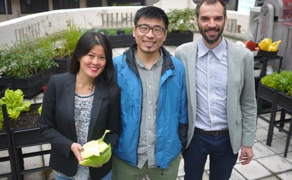 Rooftop Republic's Pol Fàbrega (left) and Andrew Tsui stand with client Gina Ma (center) amid the rooftop garden of a French restaurant in central Hong Kong.