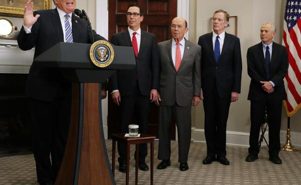 President Trump delivers remarks before signing tariff proclamations on steel and aluminum imports at the White House on March 8. Treasury Secretary Steven Mnuchin (second from left), Commerce Secretary Wilbur Ross, U.S. Trade Representative Robert Lighth