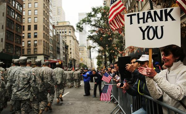 People cheer veterans in the nation's largest Veterans Day parade, in New York City Wednesday.
