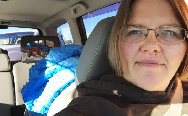 Tricia Olson takes a selfie of herself and her son Augustus, or Gus, who sits in his car seat. Olson took three weeks of unpaid leave from her job at a towing company in Rock Springs, Wyo., after giving birth.