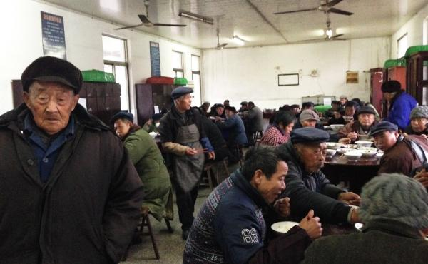 Senior citizens eat dinner in the unheated dining room of their government-funded retirement home in rapidly aging Juegang Township, Rudong County, in eastern China's Jiangsu province. Just a few years ago, the town had only one such facility; now it has