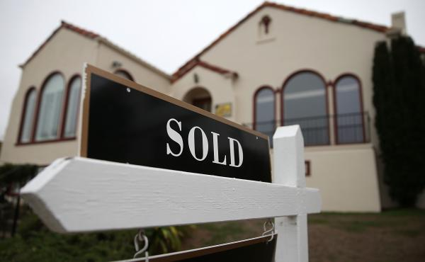 Had it gone into effect Friday, a Federal Housing Administration fee cut would have reduced the cost of borrowing for about 1 million Americans a year.