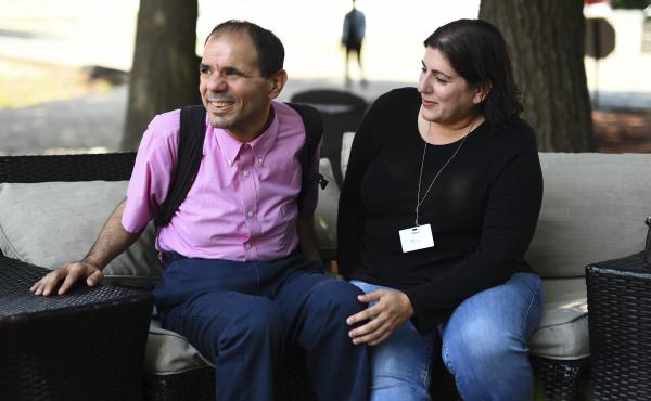 Angela Disisto, right, of Medford, Mass. with her autistic brother Luigi at the Rotenberg Educational Center in Canton, Mass. Angela says Luigi has benefited from the shock treatments and overall structure at the school. The backpack Luigi is wearing carr
