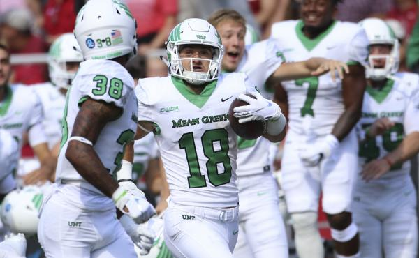North Texas Mean Green wide receiver Keegan Brewer returns a punt for a touchdown on a fake fair catch.