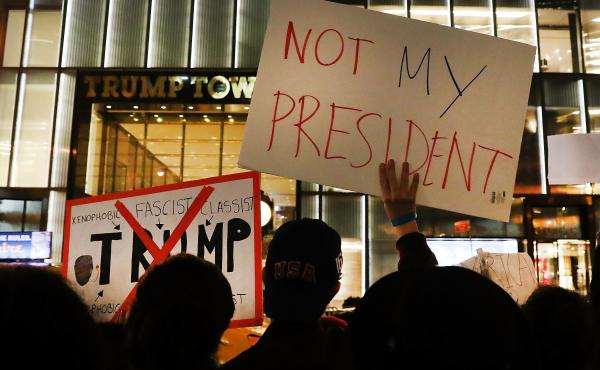 NEW YORK, NY - NOVEMBER 10: Dozens of anti-Donald Trump protesters stand along 5th Avenue in front of Trump Tower as New Yorkers react for a second night to the election of Trump as president of the United States on November 10, 2016 in New York City. Tru
