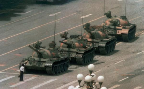 A Chinese man stands alone to block a line of tanks heading east on Beijing's Cangan Boulevard in Tiananmen Square on June 5, 1989. China faced unprecedented criticism of its brutal repression of unarmed citizens demanding more freedoms. More recently, Ch