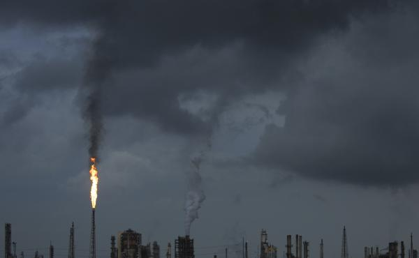 A gas flare from the Shell Chemical LP petroleum refinery illuminates the sky on Aug. 21 in Norco, La.
