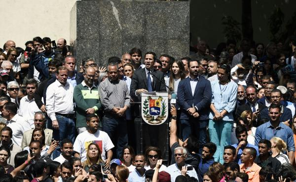 Venezuela's congressional leader, Juan Guaidó, is being recognized by a rising number of countries, including the U.S., as the South American country's interim president. Here, Guaidó (center) speaks to a crowd of opposition supporters at Bolívar Squar