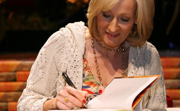 J.K. Rowling signs copies of Harry Potter and the Deathly Hallows in 2007. Many fans say they feel alienated and hurt by her recent comments.